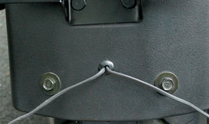 Install a rubber grommet to protect new wires from chaffing