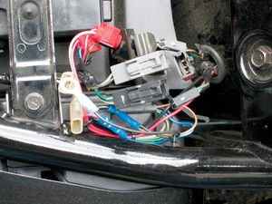 Find the taillight's wiring connector under the seat