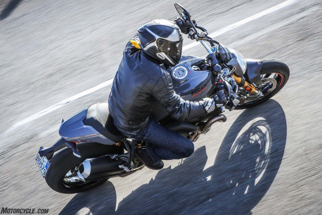The Monster has a slimmer butt for 2017, along with new Euro-4-approved mufflers and a redesigned headlight. The new tank reduces fuel capacity by 1 liter to 4.4 gallons. Note the area ahead of the fuel cap that now features a ski-boot-type buckle -- a classy retro touch for those who remember a similar latch on the original Monsters and period 900SSs. The removable seat cowl is standard equipment.