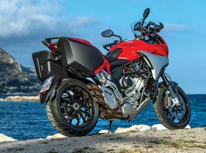 The Turismo Veloce's triple makes a pleasing bark through those three silencers. Optional saddlebags will hold a large full-face helmet. A GPS mount and Garmin GPS are available as options.